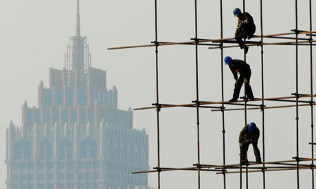 chinese builders on bamboo scaffolding